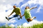 7667556-jump-of-happiness-people-on-blue-sky-and-green-grass-background